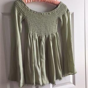Soft sage green top with gathered yoke
